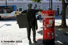 Porto newspaper delivery man statue and post box