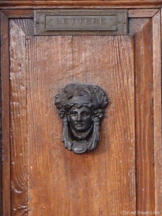 Door knocker of woman in Assisi Italy
