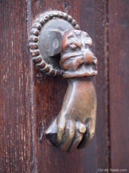 Door knocker in shape of a hand in Brussels